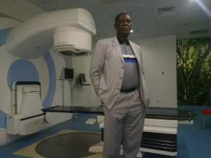 Dr. Taofeeq Ige (National Hospital Abuja, Nigeria) in front of one of the hospitals radiotherapy LINACs